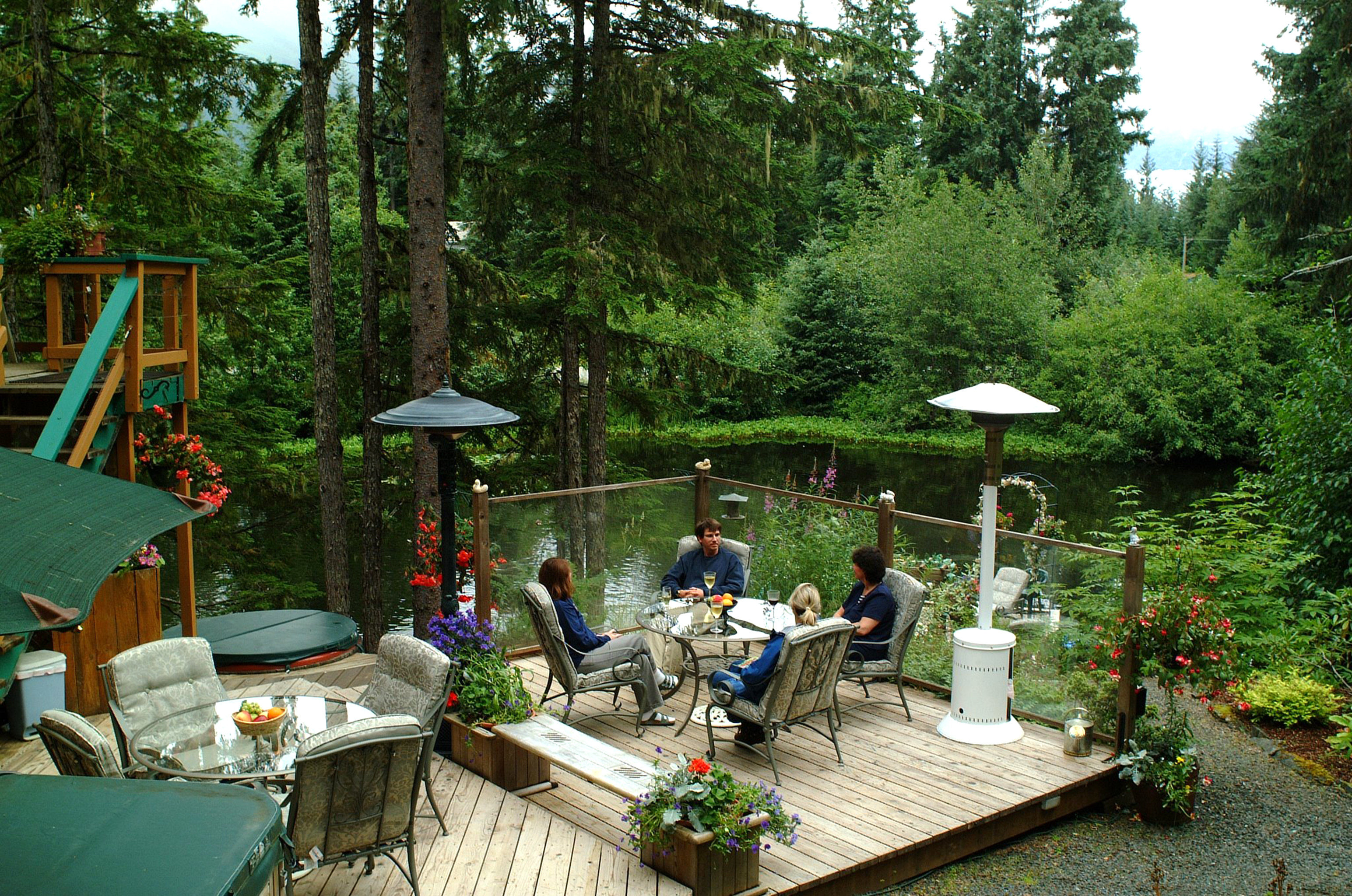 Deck Drink Eat Lake Lodge Outdoors tree backyard Garden yard park Jungle woodland