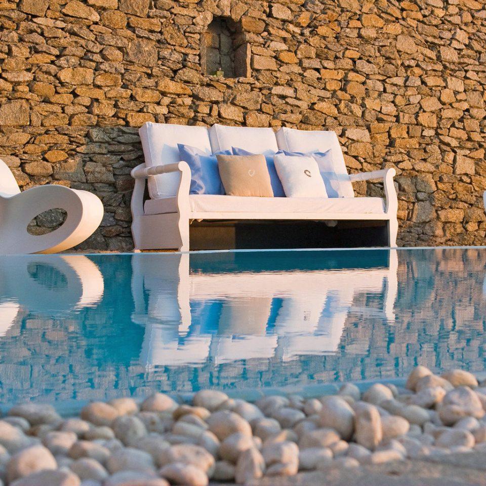 Deck Drink Lounge Patio Pool Romance Romantic Scenic views Sunset Wine-Tasting blue rock stone
