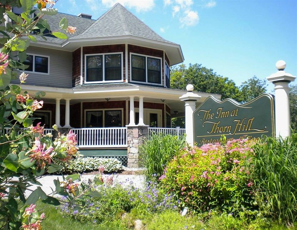 Exterior Inn tree building property home house flower residential area plant yard cottage backyard Garden lawn siding bushes outdoor structure porch mansion Resort landscaping Deck surrounded