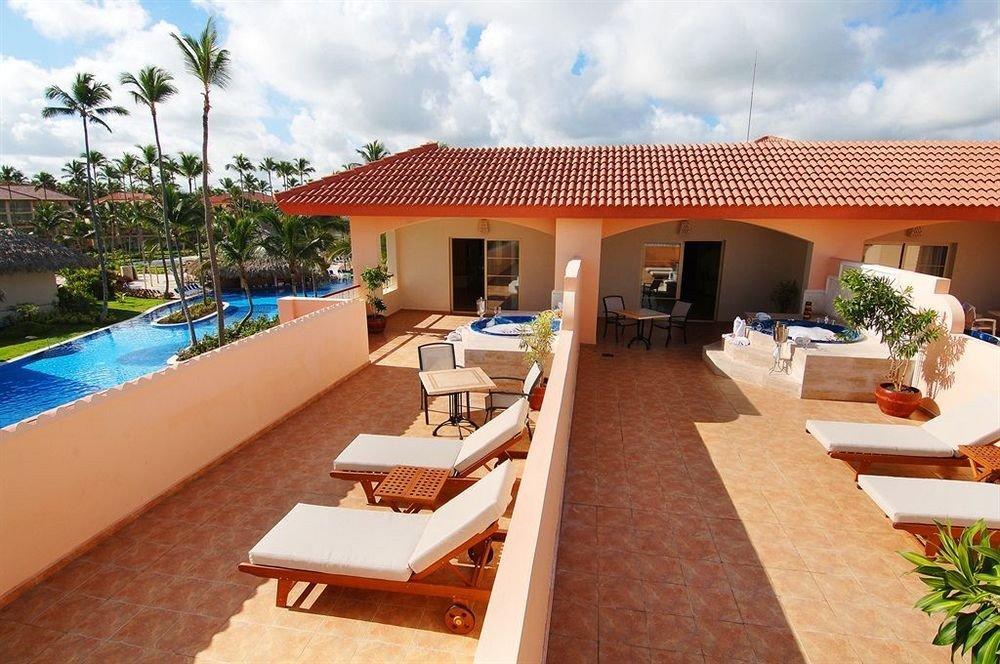 Exterior Grounds Lounge Luxury Modern Pool sky building property Resort swimming pool Villa leisure condominium home hacienda cottage caribbean eco hotel Deck Island