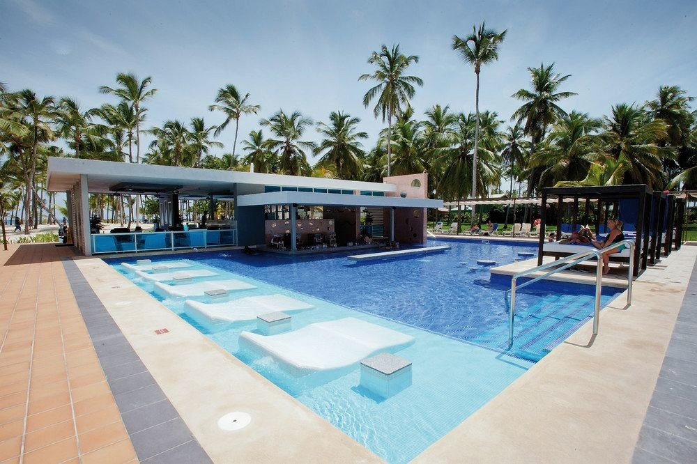 Exterior Grounds Luxury Pool Tropical tree sky building leisure swimming pool property Resort blue Villa condominium Deck