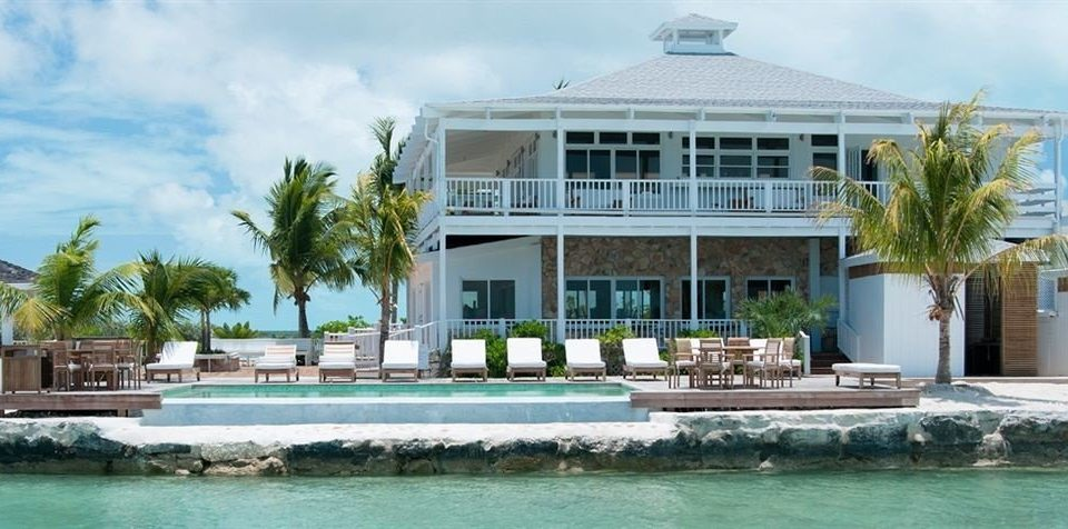 Deck Exterior Tropical Waterfront building sky house property Resort condominium swimming pool home marina Villa mansion dock palace Island stone