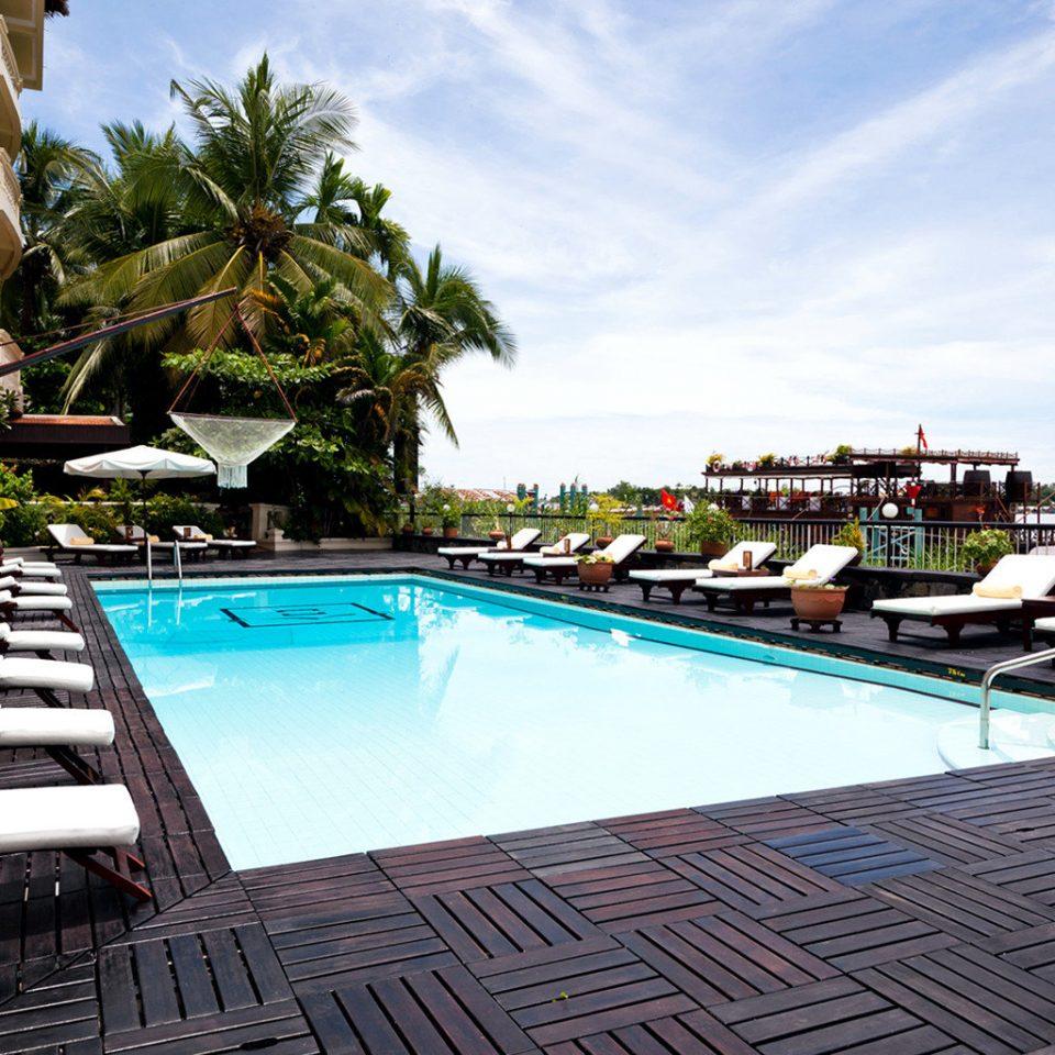 Exterior Lounge Outdoors Patio Pool Tropical sky swimming pool leisure property Resort Villa dock condominium marina backyard Deck