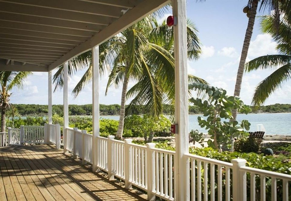 Deck Exterior Tropical Waterfront tree building porch property Resort palm walkway Villa condominium home outdoor structure cottage arecales caribbean shade colonnade