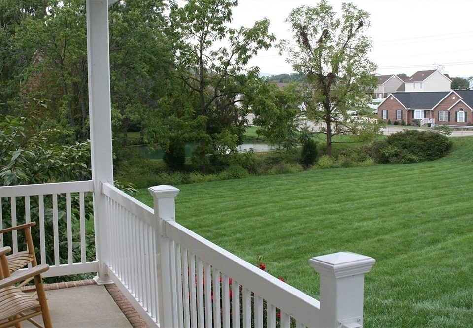 tree grass building porch property backyard home outdoor structure walkway yard Deck residential area lawn cottage Fence