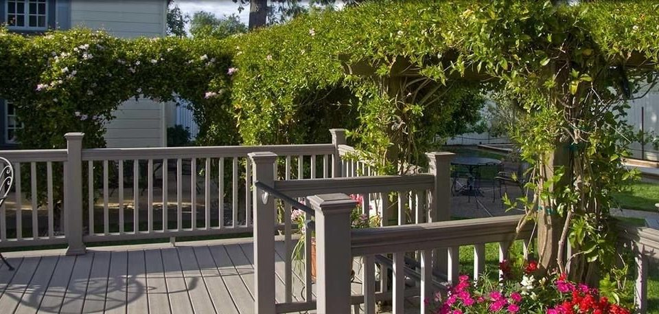 tree building porch property cottage outdoor structure backyard picket fence home Fence Villa yard Deck plant Garden