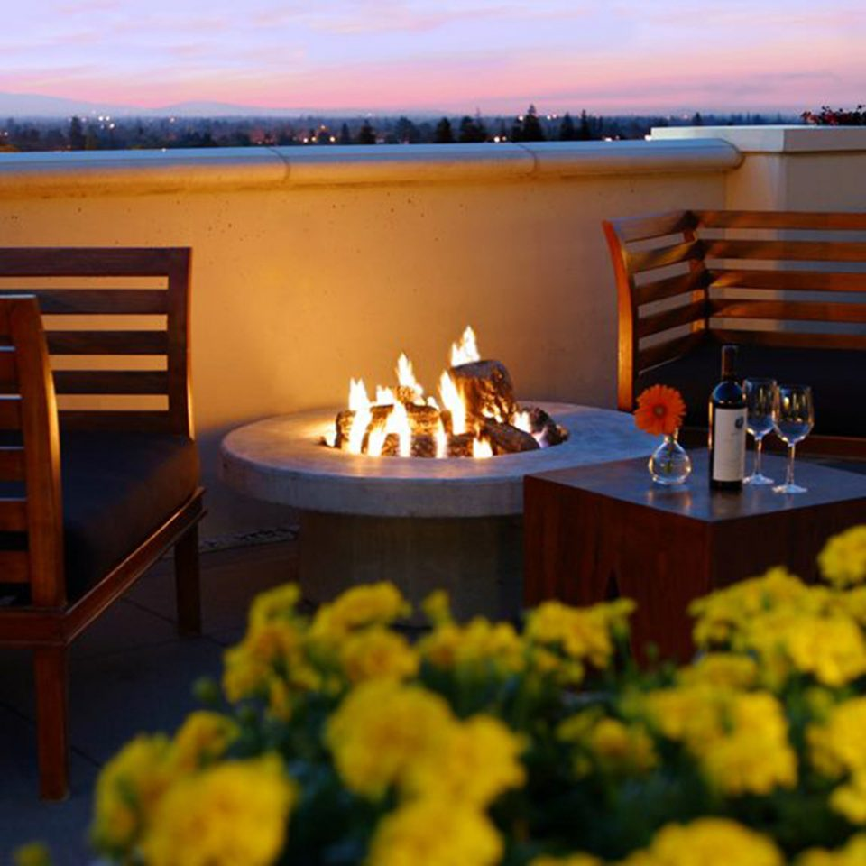 Deck Firepit Honeymoon Patio Romance Romantic Rooftop Scenic views Terrace Wine-Tasting yellow restaurant flower wooden