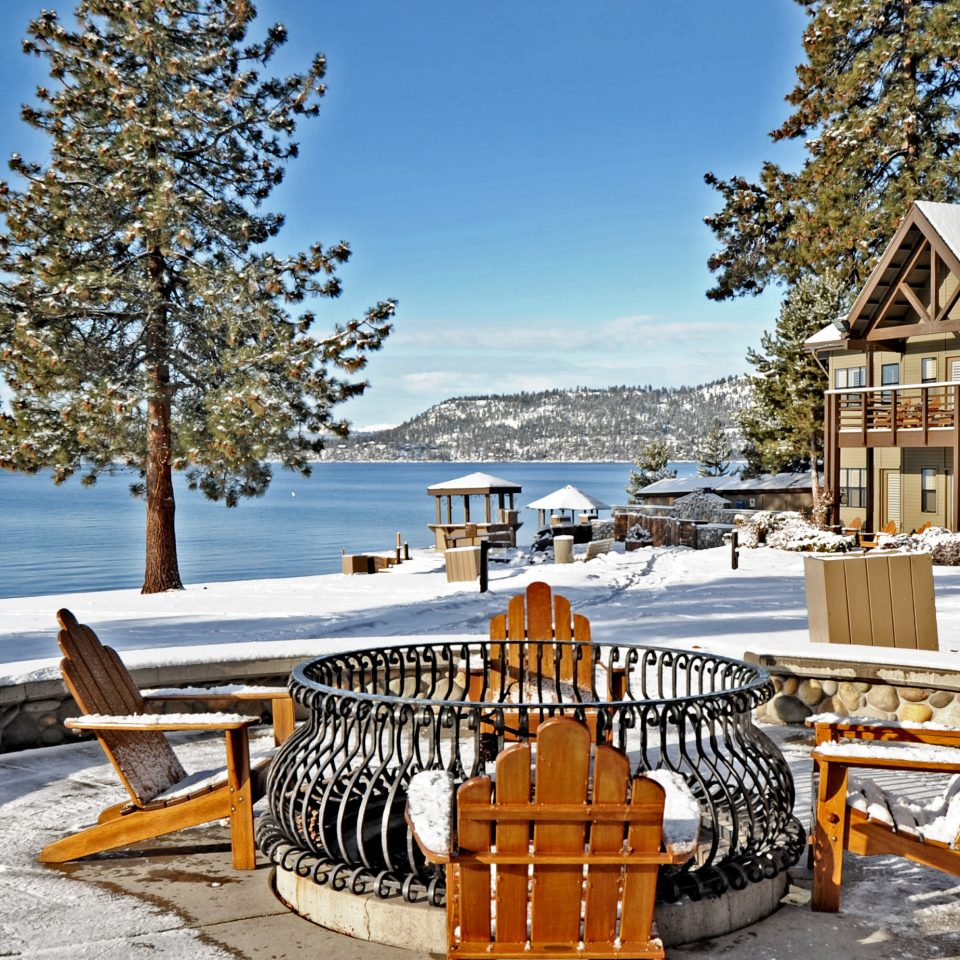 Firepit Lounge Mountains Natural wonders Nature Outdoor Activities Outdoors Scenic views Waterfront tree sky bench ground chair wooden Winter Picnic season Resort snow park home walkway Sea Lake vehicle dock log cabin overlooking Deck