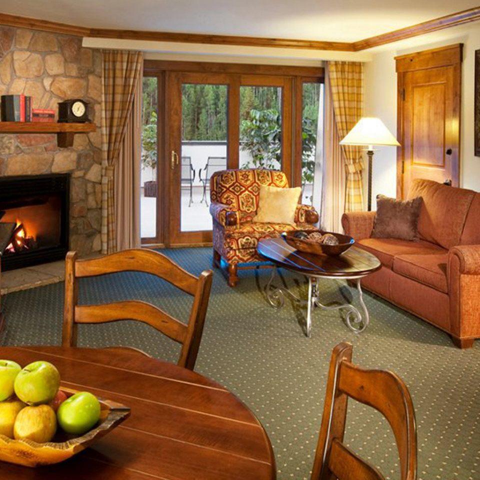 Deck Fireplace Patio Resort property living room home Suite hardwood cottage Villa mansion farmhouse