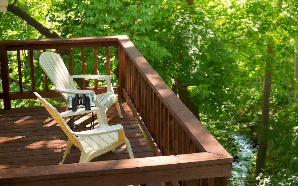 tree wooden outdoor play equipment outdoor structure Deck porch backyard swing cottage tree house Garden surrounded