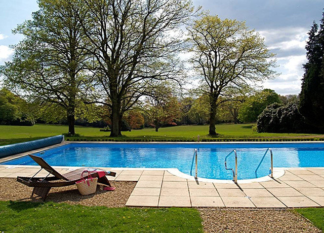 tree sky grass ground swimming pool property leisure backyard park reflecting pool Lake lawn yard Villa Garden landscape architect Deck