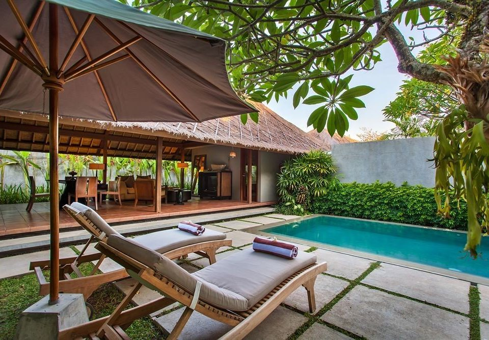 tree chair swimming pool leisure property Resort building Villa lawn Pool backyard home eco hotel hacienda cottage outdoor structure Garden Deck shade