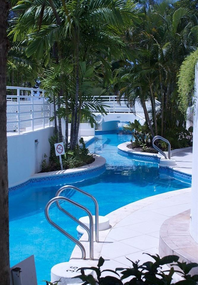 tree swimming pool leisure property building Resort Pool caribbean condominium Villa arecales backyard plant Deck Garden