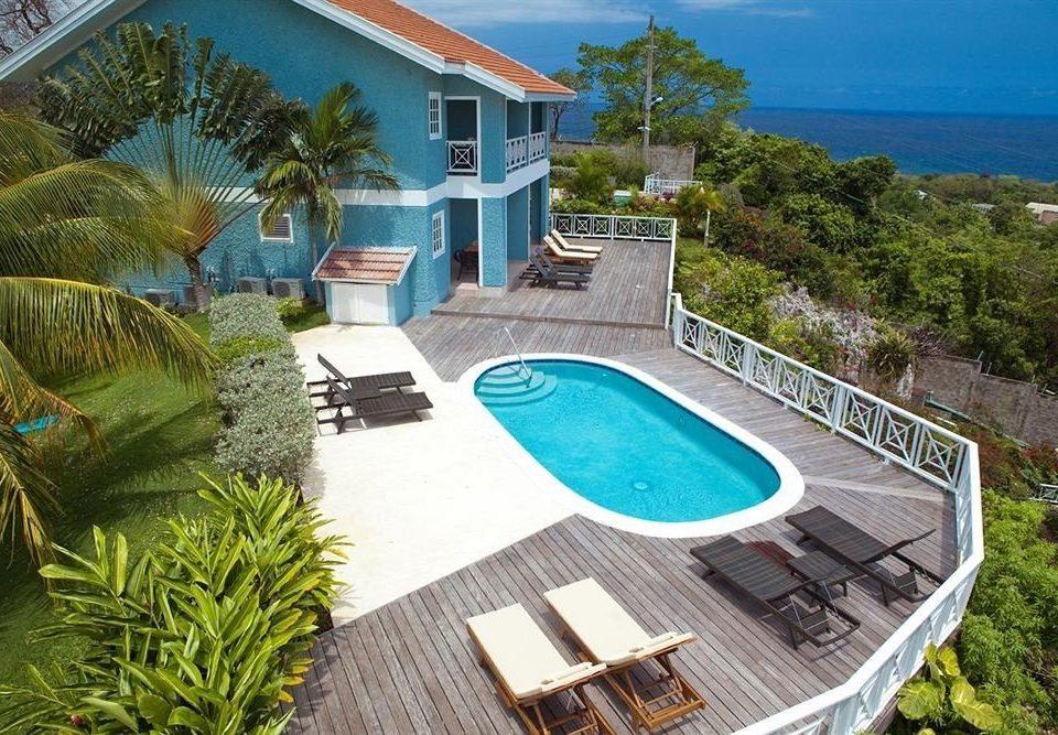 tree swimming pool property leisure Villa condominium Resort backyard home mansion caribbean plant Garden Deck