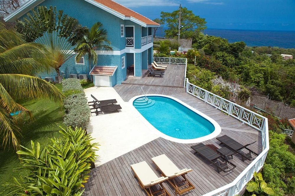 tree swimming pool property leisure Villa condominium Resort backyard home mansion caribbean plant Garden Deck
