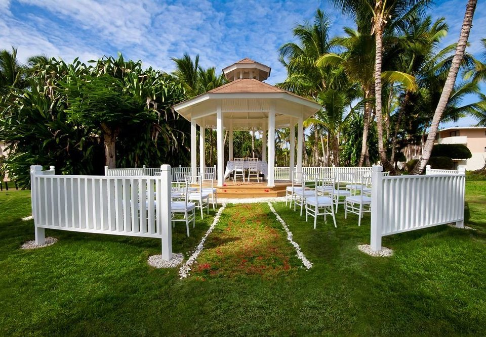 grass tree building property lawn backyard outdoor structure gazebo Villa porch cottage home mansion house grassy Deck set Garden surrounded lush