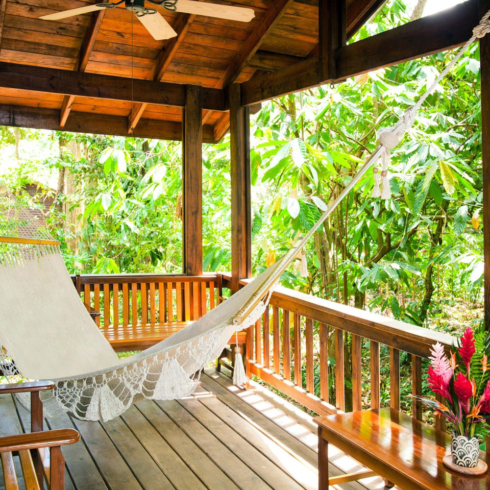 Hip Lounge Luxury Tropical tree wooden building porch Resort outdoor structure cottage backyard eco hotel Jungle Deck