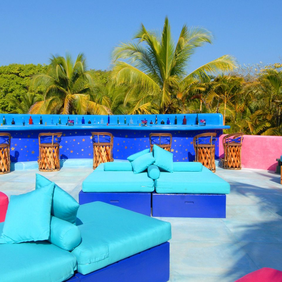 Deck Hip Lounge tree sky leisure swimming pool Resort Water park amusement park Villa blue colorful sofa colored