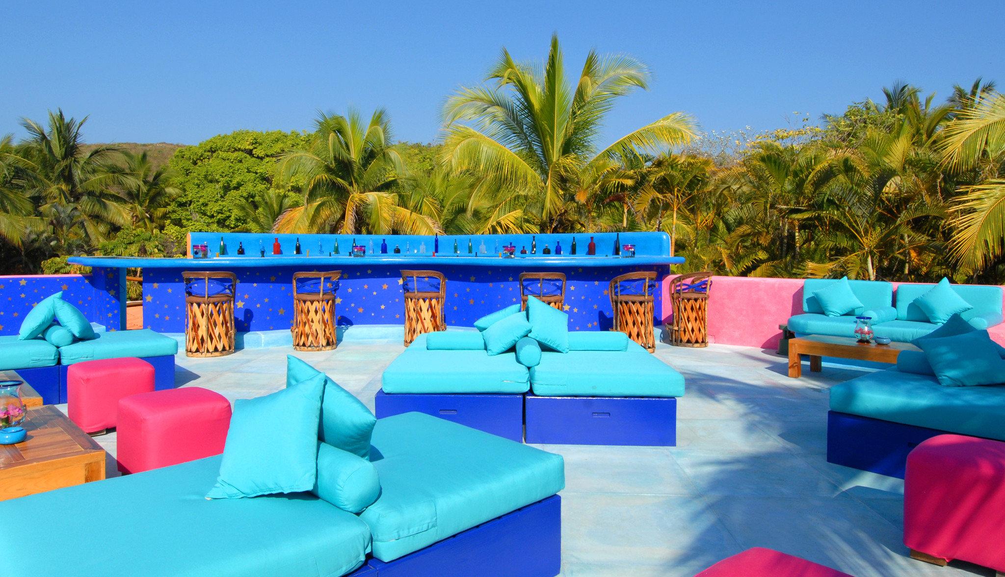 Deck Hip Lounge tree sky leisure swimming pool Resort Water park amusement park Villa blue colorful sofa colored
