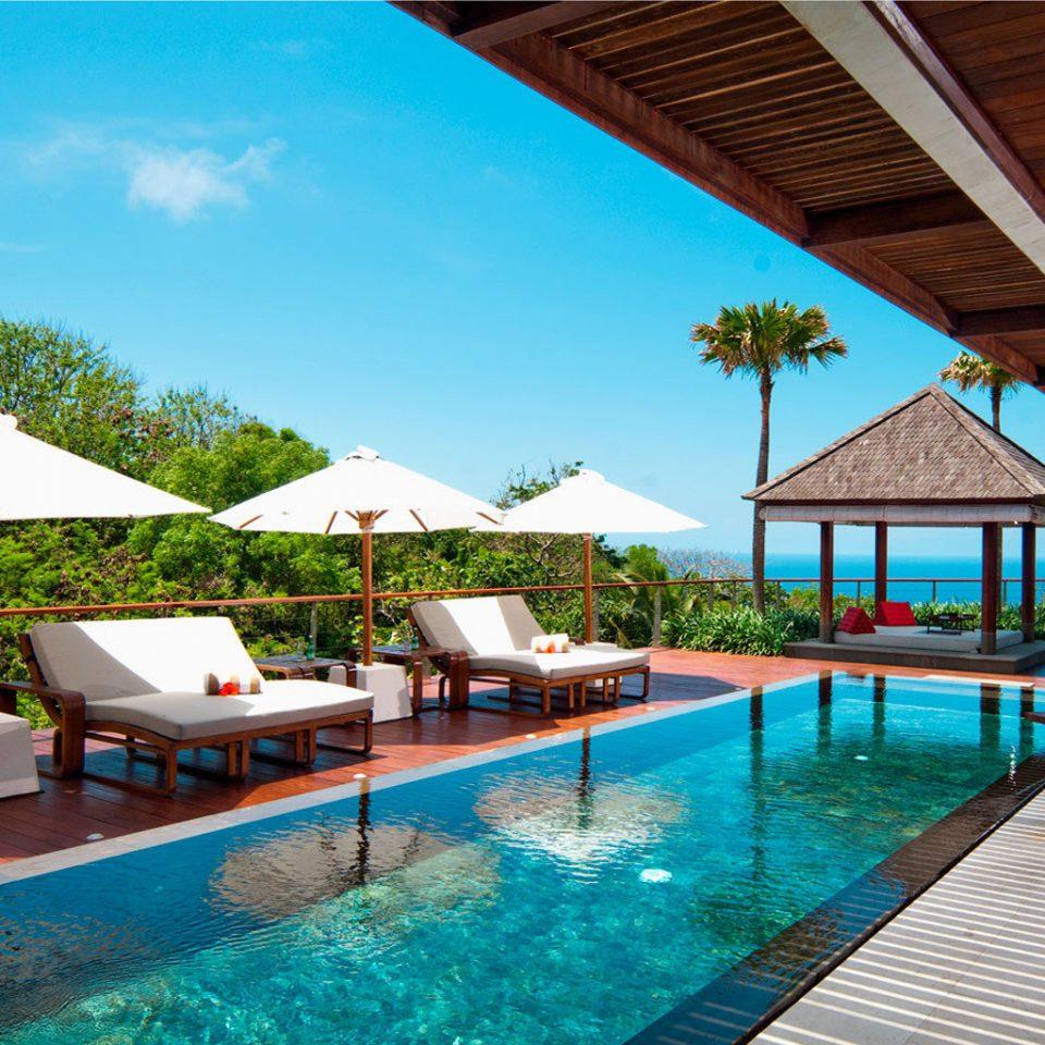 Honeymoon Luxury Pool Romance umbrella water swimming pool leisure chair property building Resort swimming Villa caribbean lawn eco hotel backyard blue Deck