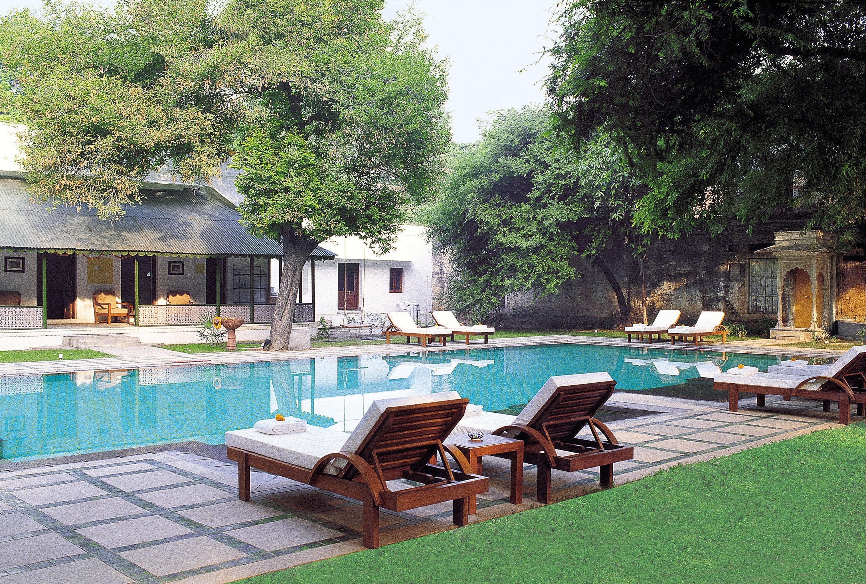Honeymoon Patio Pool tree chair swimming pool property leisure building Villa lawn backyard Resort cottage hacienda mansion condominium eco hotel set Deck