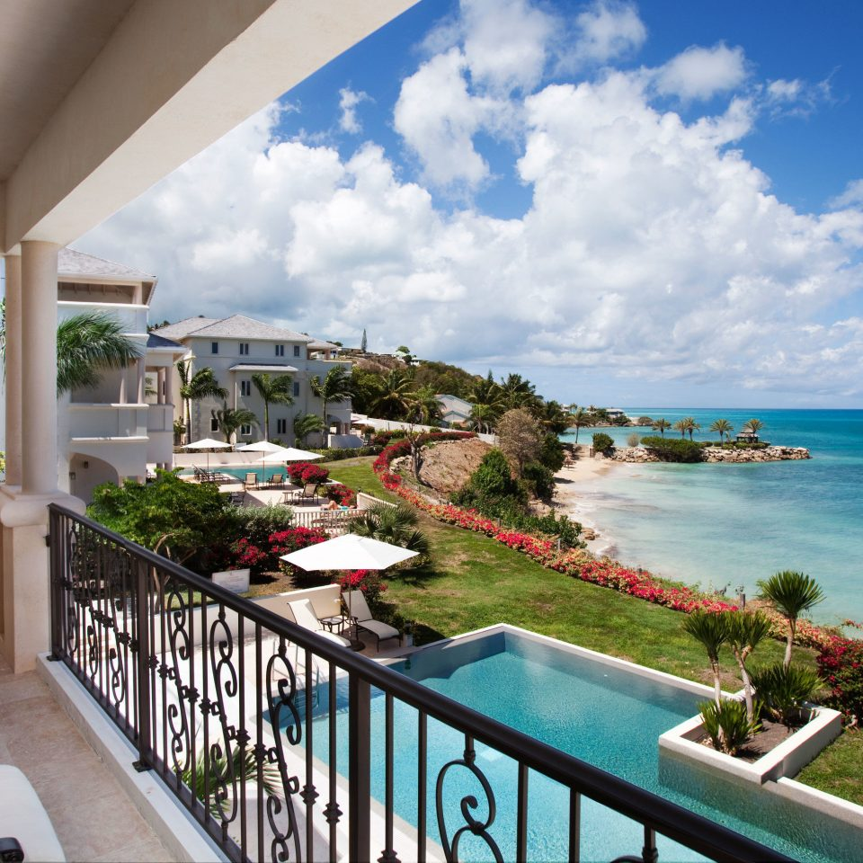 Hotels Trip Ideas sky property leisure caribbean Resort swimming pool home Villa condominium Deck porch overlooking