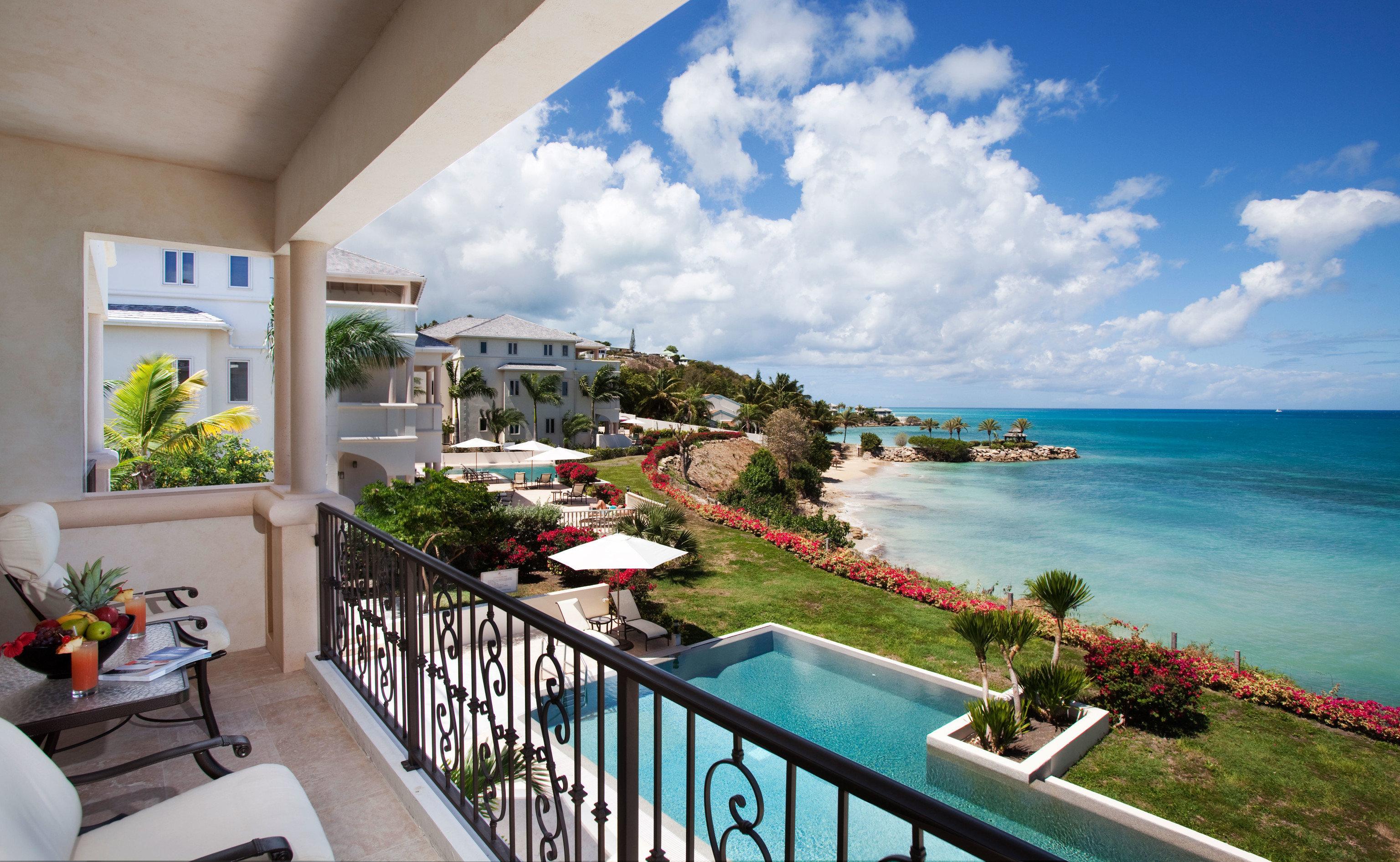 Hotels Trip Ideas sky property leisure caribbean Resort swimming pool home Villa condominium Deck porch overlooking