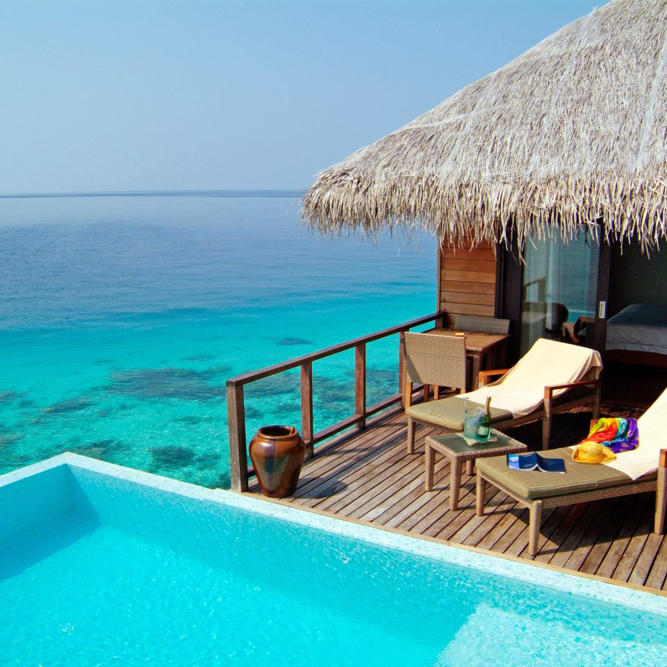 Island Luxury Overwater Bungalow Pool Romance Romantic Waterfront water sky umbrella chair swimming pool leisure property caribbean Villa Resort blue Sea cottage Lagoon swimming overlooking Deck