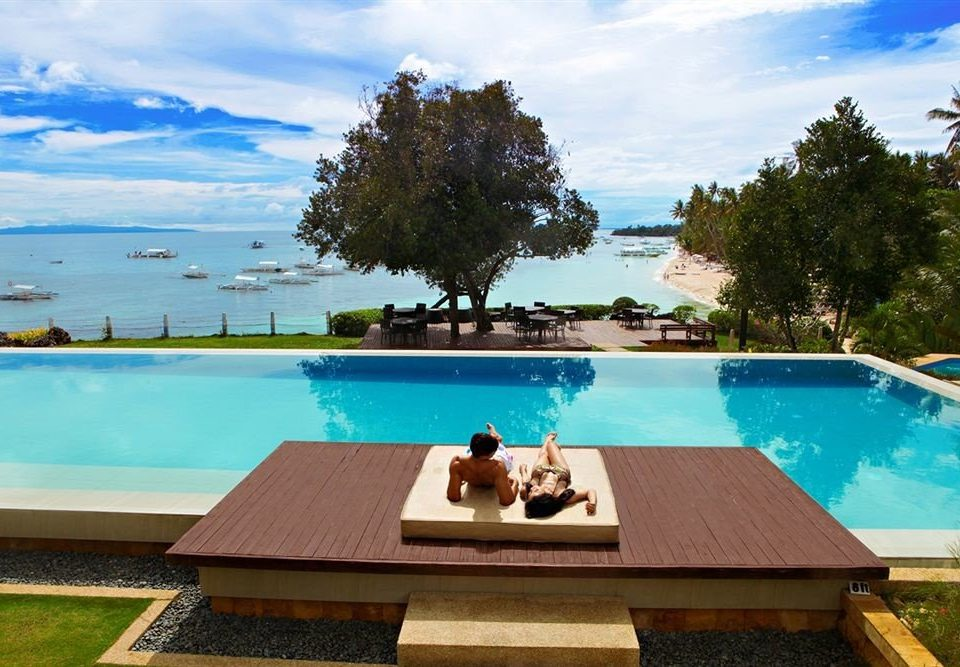 tree water sky swimming pool leisure property wooden Resort Villa backyard Lake Pool overlooking shore Deck swimming Island
