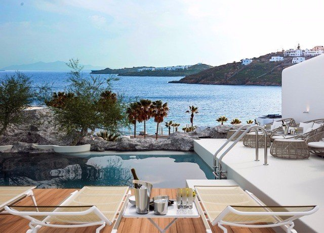 water sky property chair swimming pool Resort Deck Villa Nature caribbean overlooking shore Island