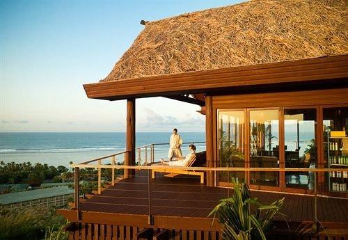 sky water chair property wooden building Resort Villa overlooking cottage Ocean eco hotel Deck Island