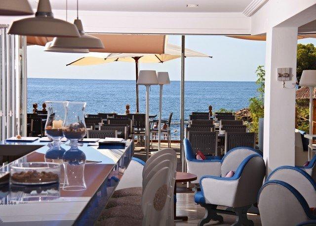 water chair property Resort Ocean restaurant home Villa cottage Deck overlooking Island day shore