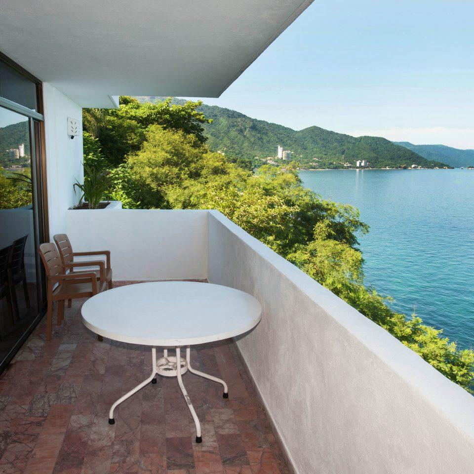 water sky property swimming pool house Villa home condominium overlooking porch Deck Island