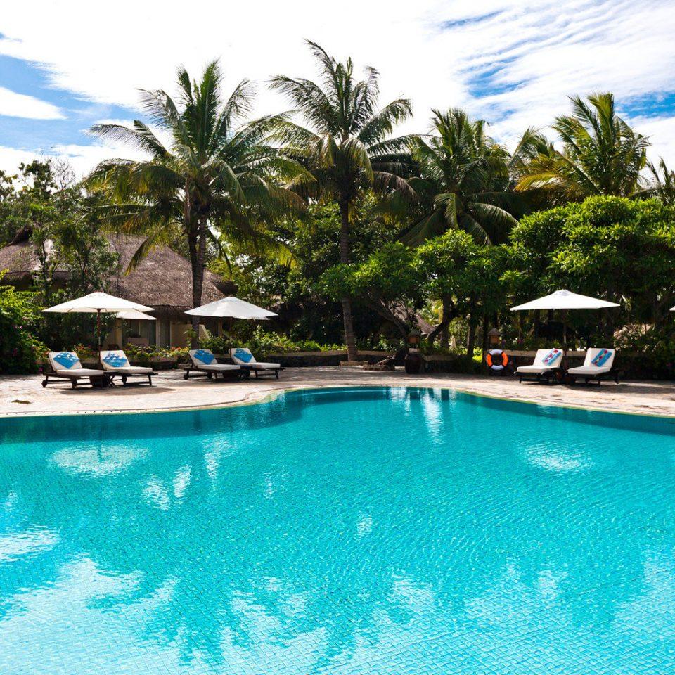 Deck Jungle Lounge Patio Pool Resort Spa Tropical Waterfront tree water sky swimming pool swimming property leisure resort town Villa blue caribbean Lagoon condominium reef day