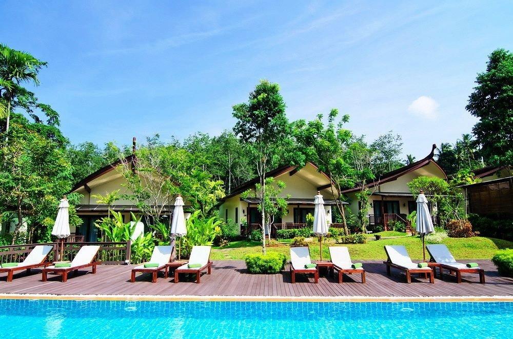 tree sky leisure swimming pool property Resort Pool Villa Village lawn backyard Jungle mansion hacienda Water park lined Deck swimming
