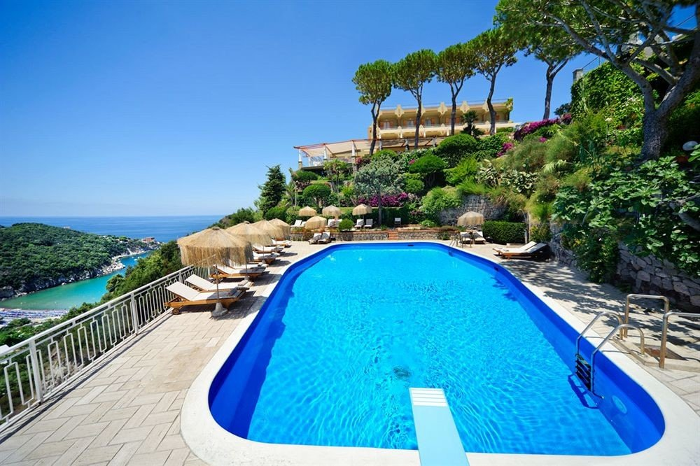 sky tree swimming pool leisure property Resort Pool caribbean Villa resort town blue Lagoon Water park Deck