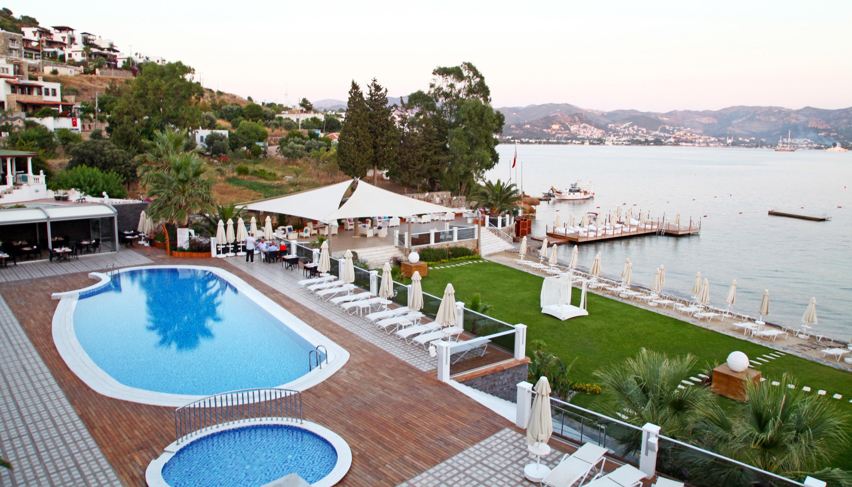 Lobby Modern Patio Pool Terrace Waterfront sky water leisure property swimming pool Resort marina dock resort town waterway Villa Deck overlooking