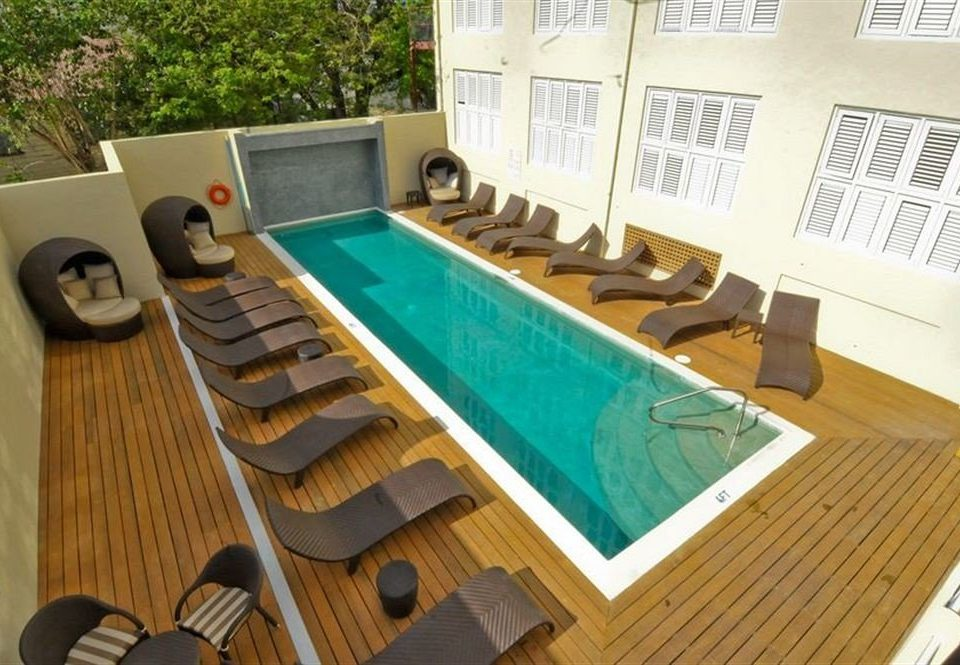 Deck Lounge Luxury Modern Pool property swimming pool leisure wooden Villa home condominium flooring Resort cottage