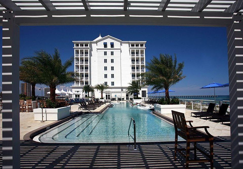 Lounge Luxury Pool condominium property swimming pool building home walkway marina dock empty Deck Resort