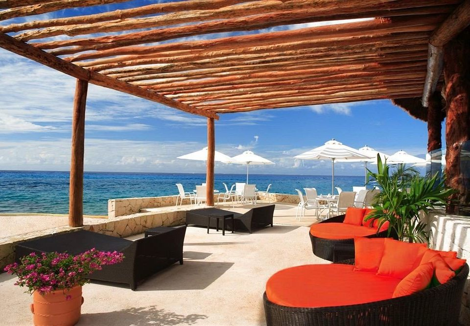 Lounge Modern Ocean Resort Waterfront property leisure swimming pool Villa caribbean cottage Deck hacienda overlooking shore
