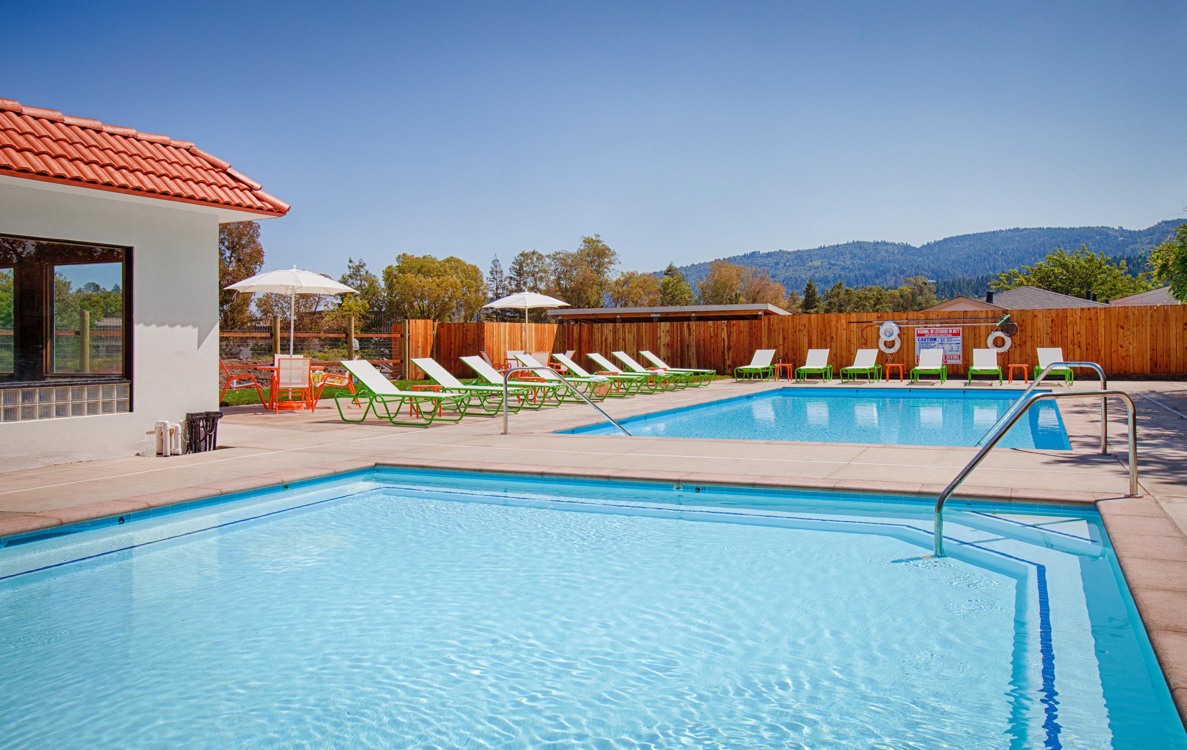 Deck Lounge Modern Patio Pool swimming pool leisure property building Resort Villa backyard home blue swimming
