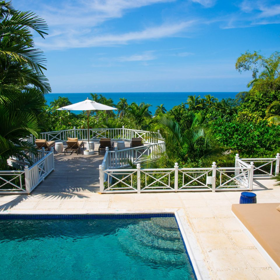 Lounge Ocean Patio Pool Scenic views tree ground swimming pool building leisure property Resort Villa caribbean backyard Deck condominium shade