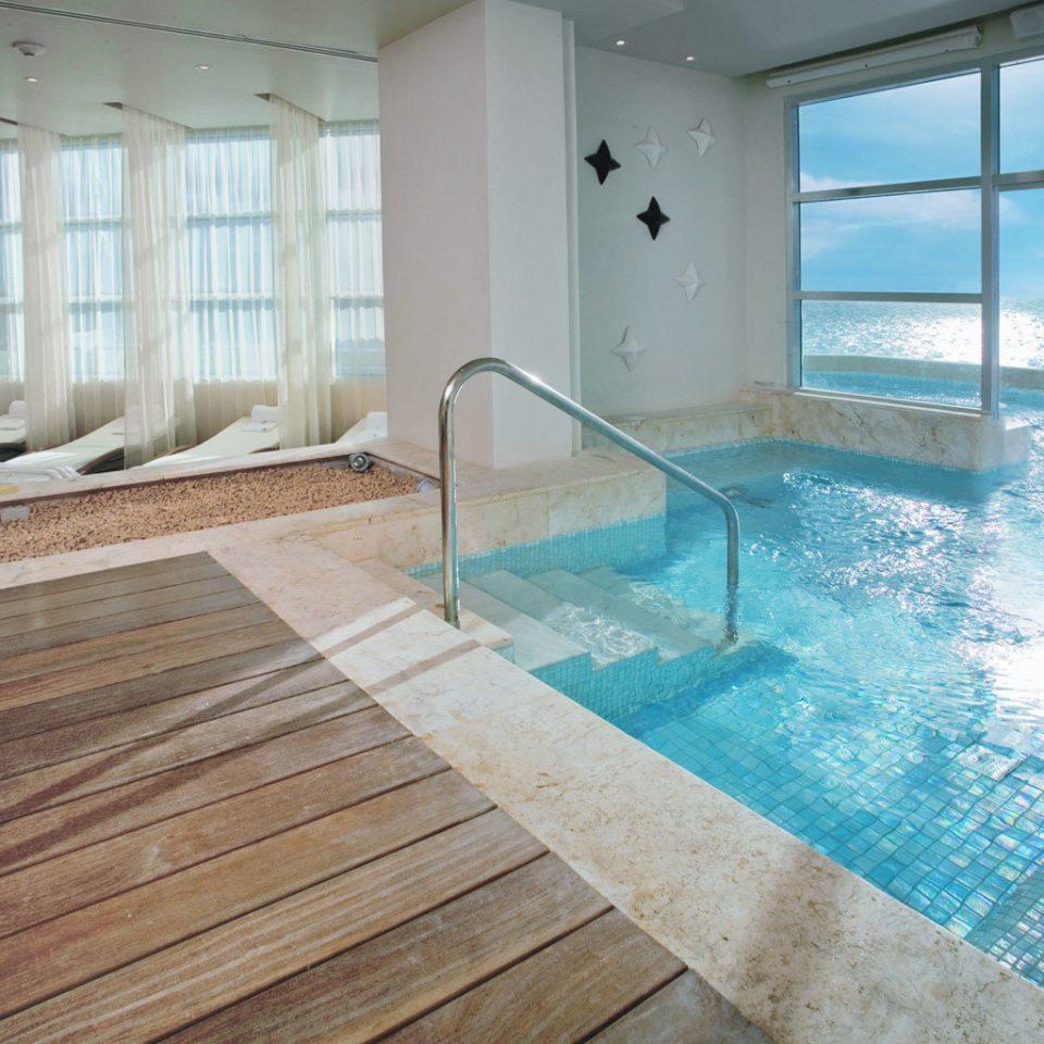 Deck Lounge Pool Scenic views building swimming pool property hardwood flooring jacuzzi wood flooring tub