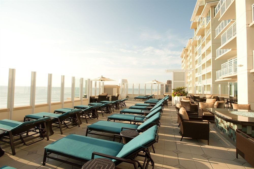 Deck Lounge Waterfront chair leisure condominium plaza park convention center Resort headquarters lined overlooking