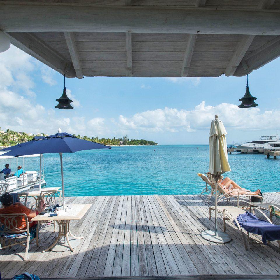 water sky chair Sea Ocean vehicle swimming pool caribbean yacht Resort dock Deck shore day