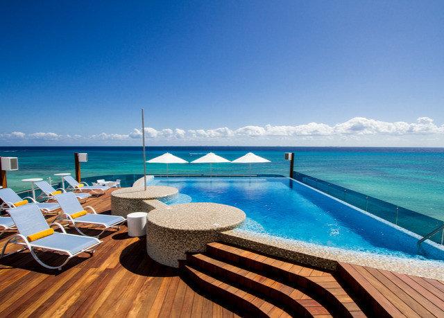 sky water chair swimming pool property leisure caribbean Ocean Resort Sea Villa shore Deck day