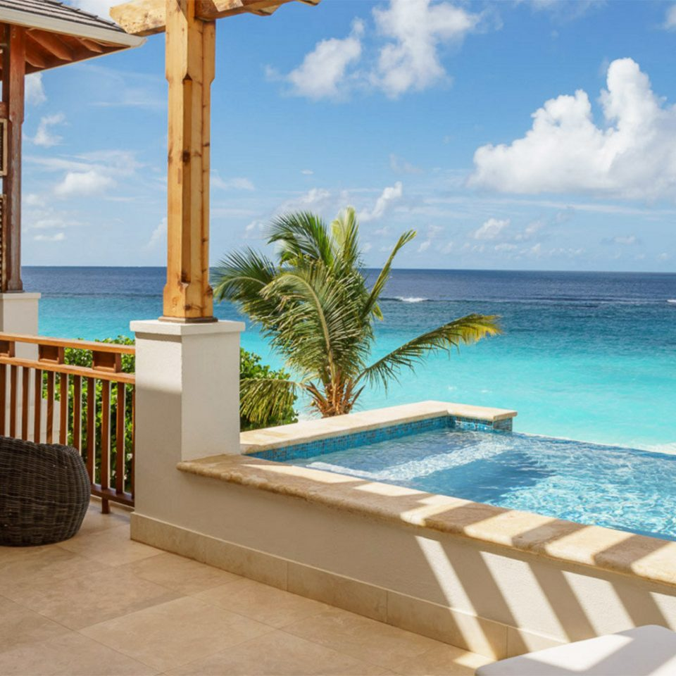 sky water swimming pool chair property caribbean Resort Villa leisure Ocean condominium Deck cottage Suite shore day