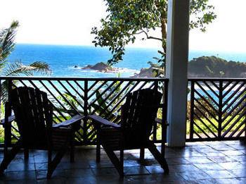 sky water property building Resort Ocean Villa home porch hacienda cottage overlooking Deck