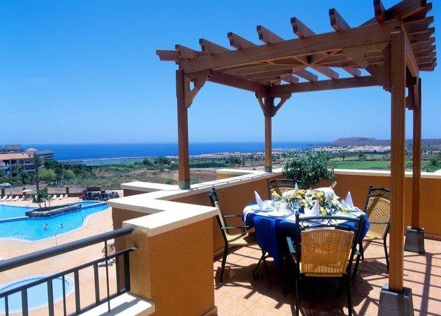 chair sky property Resort leisure Villa wooden Ocean overlooking cottage outdoor structure condominium swimming pool Deck set shore