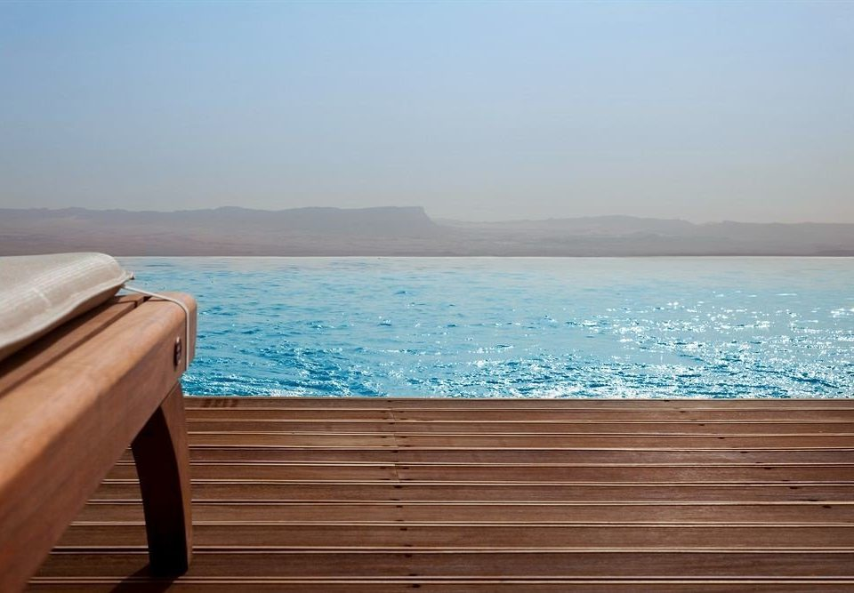 water sky sitting swimming pool Sea Ocean wooden facing overlooking shore empty Deck
